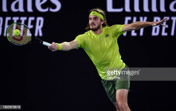 Stefanos Tsitsipas of Greece hits a forehand against Daniil Medvedev of Russia in the men's singles semi-finals during day 12 of the 2021 Australian...