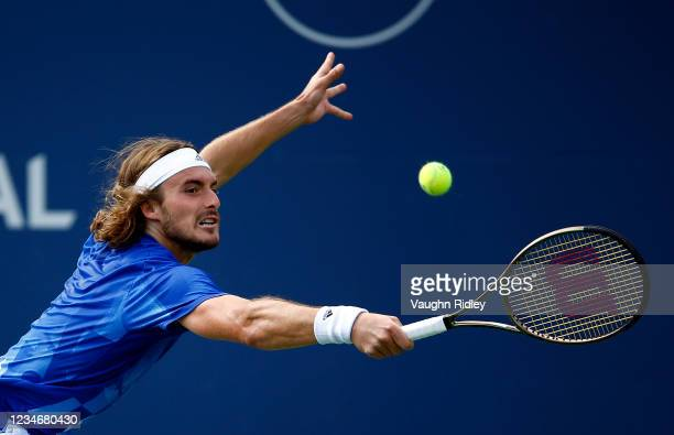 Stefanos Tsitsipas of Greece hits a shot against Reilly Opelka of the United States during a semifinal match on Day Six of the National Bank Open at...