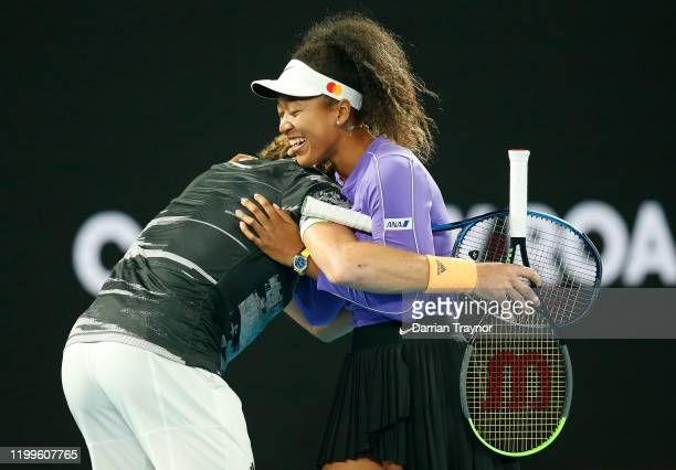 Stefanos Tsitsipas of Greece hugs Naomi Osaka of Japan during the Rally for Relief Bushfire Appeal event at Rod Laver Arena on January 15 2020 in...