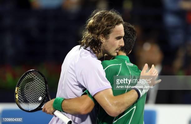 Stefanos Tsitsipas of Greece hugs Novak Djokovic of Serbia after their final on Match Day thirteen of the Dubai Duty Free Tennis at Dubai Duty Free...