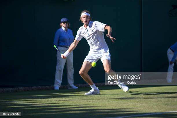 Stefanos Tsitsipas of Greece in action against Gregoire Barrere of France in the Gentlemen's Singles First Round match on Court Eighteen during the...