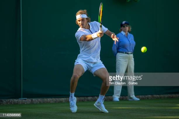 Stefanos Tsitsipas of Greece in action against Gregoire Barrere of France on Court 18 in the Gentlemenu2019s Singles Championship during the...