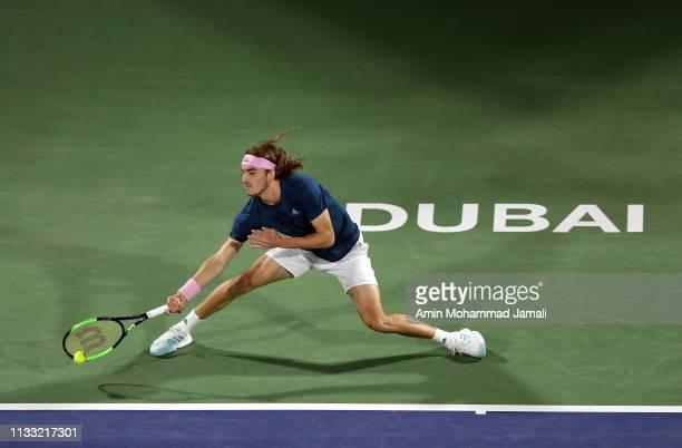 Stefanos Tsitsipas of Greece in action against Roger Federer of Switzerland during day Fourteen of the Dubai Duty Free Tennis Stadium on at Dubai...