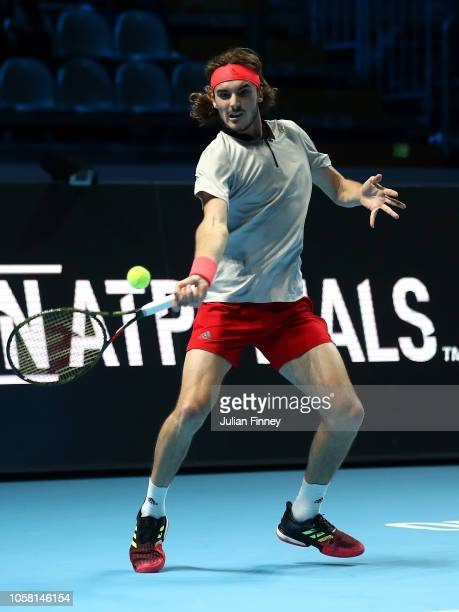 Stefanos Tsitsipas of Greece in action in his group match against Jaume Munar of Spain during Day One of the Next Gen ATP Finals at Fiera Milano Rho...