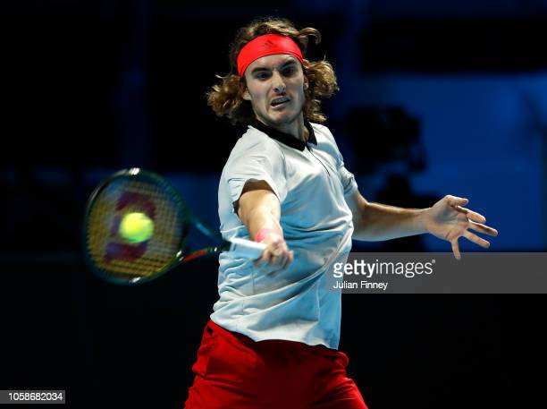 Stefanos Tsitsipas of Greece in action in his group match against Frances Tiafoe of USA during Day Two of the Next Gen ATP Finals at Fiera Milano Rho...