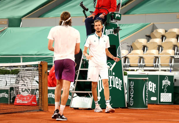 Stefanos Tsitsipas of Greece is congratulated by Daniil Medvedev of Russia after their mens singles quarter final match during day ten of the 2021...