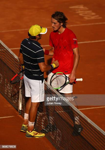 Stefanos Tsitsipas of Greece is congratulated by Dusan Lajovic of Serbia during day one of the Internazionali BNL d'Italia 2018 tennis at Foro...