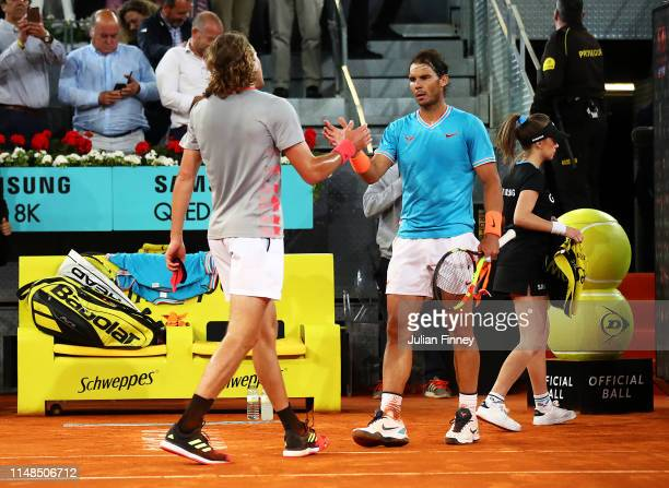 Stefanos Tsitsipas of Greece is congratulated by Rafael Nadal of Spain after his win in the semi finals during day eight of the Mutua Madrid Open at...