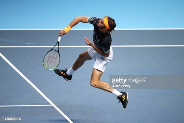 Stefanos Tsitsipas of Greece jumps to play a forehand volley in his singles match against Daniil Medvedev of Russia during Day Two of the Nitto ATP...
