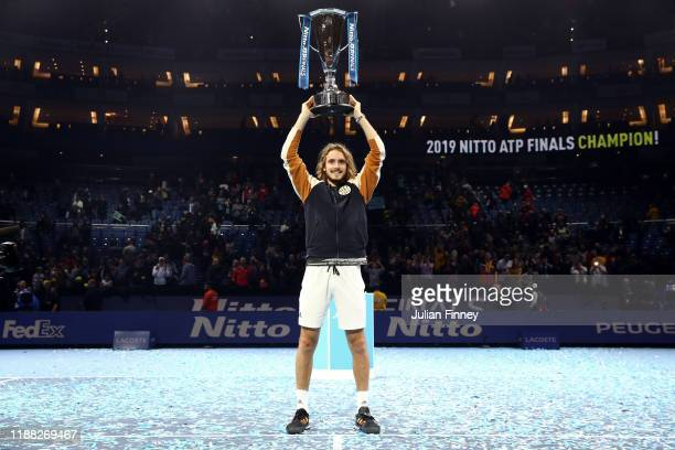 Stefanos Tsitsipas of Greece lifts the trophy after his singles final match victory against Dominic Thiem of Austria during Day Eight of the Nitto...