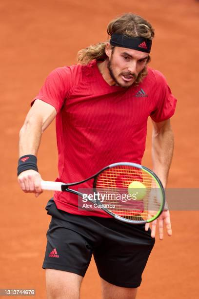 Stefanos Tsitsipas of Greece plays a backhand against Jaume Munar of Spain in their second round match during day three of the Barcelona Open Banc...