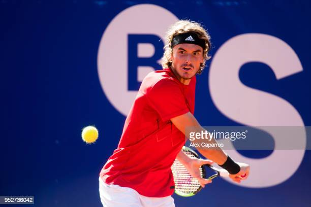 Stefanos Tsitsipas of Greece plays a backhand against Rafael Nadal of Spain in their final match during day seven of the Barcelona Open Banc Sabadell...