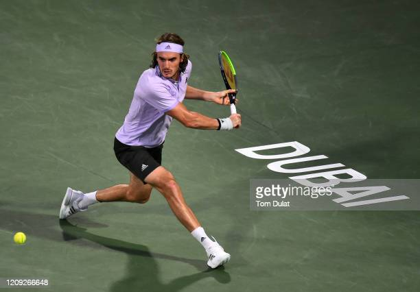 Stefanos Tsitsipas of Greece plays a backhand during his men's semi final match against Daniel Evans of Great Britain on Day 12 of the Dubai Duty...