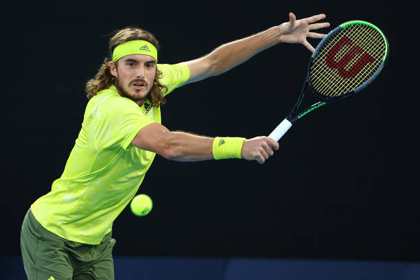Stefanos Tsitsipas of Greece plays a backhand his Men's Singles Semifinals match against Daniil Medvedev of Russia during day 12 of the 2021...