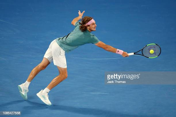 Stefanos Tsitspas of Greece plays a backhand in his fourth round match against Roger Federer of Switzerland during day seven of the 2019 Australian...