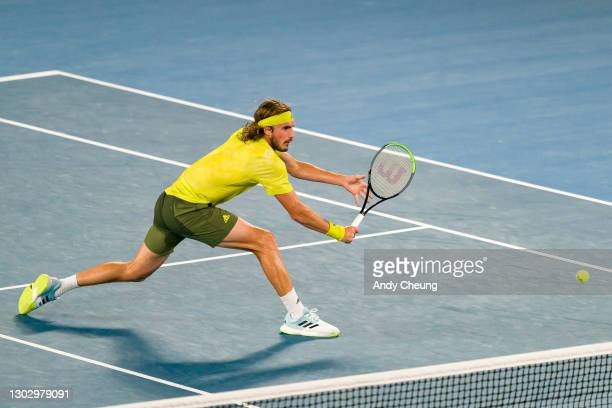 Stefanos Tsitsipas of Greece plays a backhand in his Men's Singles Semifinals match against Daniil Medvedev of Russia during day 12 of the 2021...