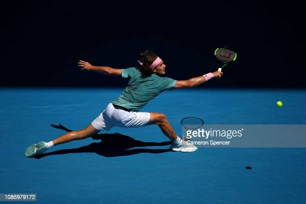 Stefanos Tsitsipas of Greece plays a backhand in his quarter final match against Roberto Bautista Agut of Spain during day nine of the 2019...