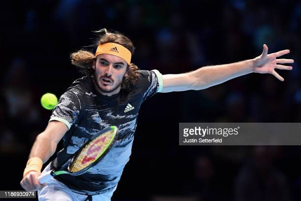 Stefanos Tsitsipas of Greece plays a backhand in his singles match against Daniil Medvedev of Russia during Day Two of the Nitto ATP Finals at The O2...