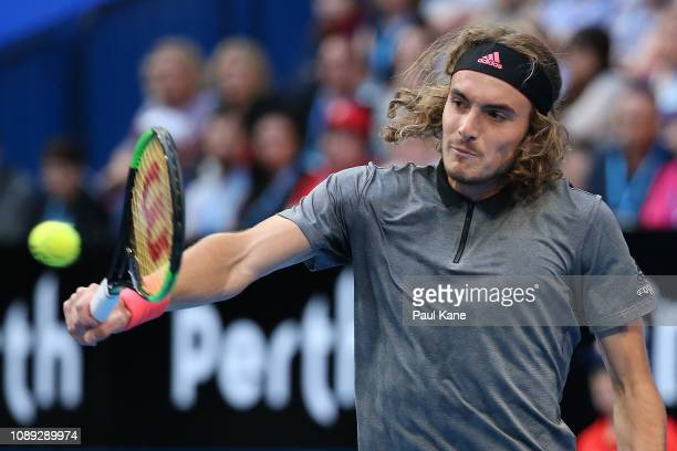 Stefanos Tsitsipas of Greece plays a backhand to Roger Federer of Switzerland during day six of the 2019 Hopman Cup at RAC Arena on January 03 2019...