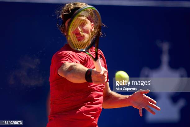 Stefanos Tsitsipas of Greece plays a forehand against Felix Auger-Aliassime of Canada in their quarter-final match during day five of the Barcelona...