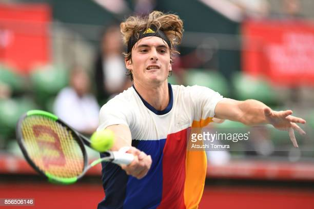Stefanos Tsitsipas of Greece plays a forehand against Marin Cilic of Croatia during day one of the Rakuten Open at Ariake Coliseum on October 2 2017...