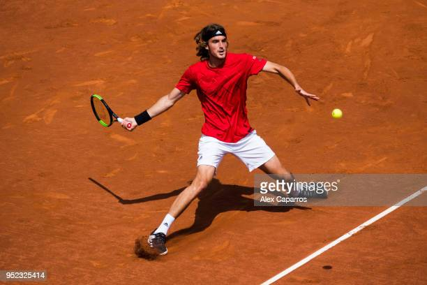 Stefanos Tsitsipas of Greece plays a forehand against Pablo Carreno of Spain in their semifinal match during day six of the Barcelona Open Banc...