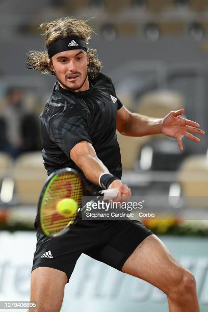 Stefanos Tsitsipas of Greece plays a forehand during his Men's Singles semifinals match against Novak Djokovic of Serbia on day thirteen of the 2020...