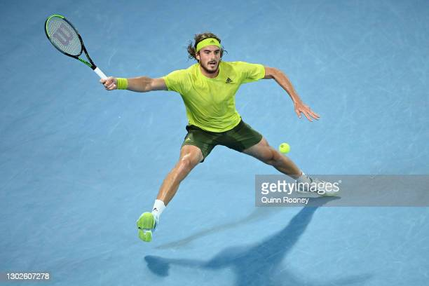 Stefanos Tsitsipas of Greece plays a forehand during his Men's Singles Quarterfinals match against Rafael Nadal of Spain during day 10 of the 2021...