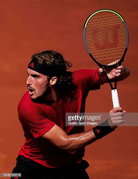 Stefanos Tsitsipas of Greece plays a forehand during his Men's Singles final match against Rafael Nadal of Spain on day seven of the Barcelona Open...