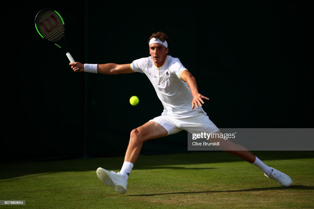 Stefanos Tsitsipas of Greece plays a forehand during the Gentlemen's Singles first round match against Dusan Lajovic of Serbia on day two of the Wimbledon Lawn Tennis Championships at the All England Lawn Tennis and Croquet Club on July 4, 2017 in London, England.