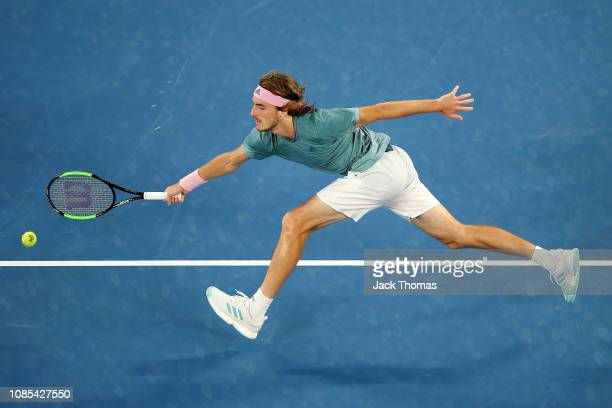 Stefanos Tsitspas of Greece plays a forehand in his fourth round match against Roger Federer of Switzerland during day seven of the 2019 Australian...