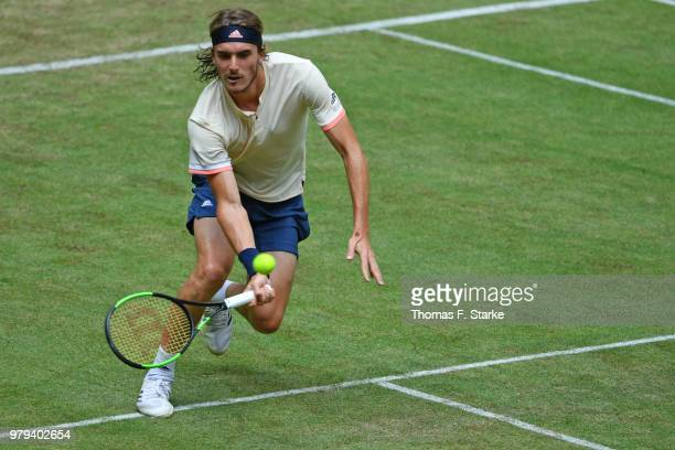 Stefanos Tsitsipas of Greece plays a forehand in his match against Denis Kudla of the United States during day three of the Gerry Weber Open at Gerry...