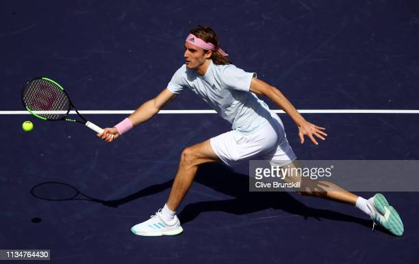 Stefanos Tsitsipas of Greece plays a forehand volley against Felix AugerAliassime of Canada during their men's singles second round match on day six...