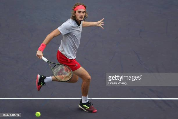 Stefanos Tsitsipas of Greece plays a shot against Gael Monfils of France during First Round in 2018 Rolex Shanghai Masters on Day 2 at Qi Zhong...