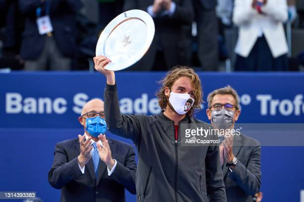 Stefanos Tsitsipas of Greece poses with the finalist trophy after his defeat against Rafael Nadal of Spain in their final match during day seven of...