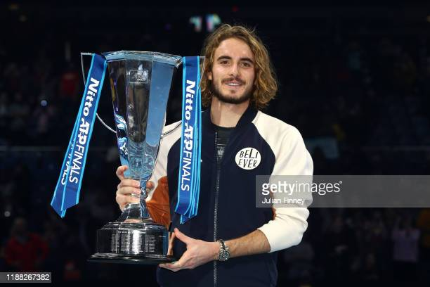 Stefanos Tsitsipas of Greece poses with the trophy after his singles final match victory against Dominic Thiem of Austria during Day Eight of the...