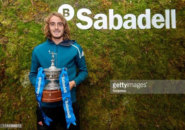 Stefanos Tsitsipas of Greece poses with the trophy during Open Banc Sabadell 2019 on April 22 2019 in Barcelona Spain