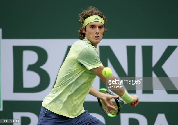 Stefanos Tsitsipas of Greece returns a backhand to Dominic Thiem of Austria during the BNP Paribas Open on March 10 2018 at the Indian Wells Tennis...