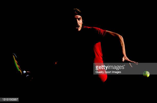 Stefanos Tsitsipas of Greece returns a ball during his Men's Singles final match against Rafael Nadal of Spain on day seven of the Barcelona Open...