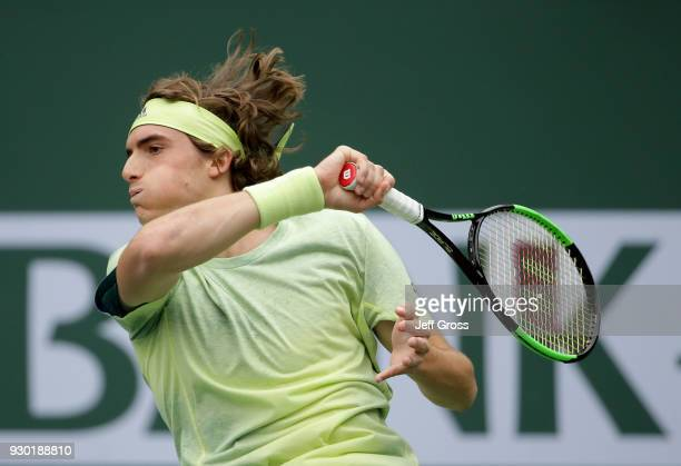 Stefanos Tsitsipas of Greece returns a foreand to Dominic Thiem of Austria during the BNP Paribas Open on March 10 2018 at the Indian Wells Tennis...