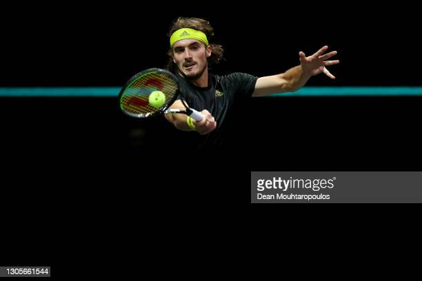 Stefanos Tsitsipas of Greece returns a forehand in his match against Andrey Rublev of Russia during Day 6 of the 48th ABN AMRO World Tennis...