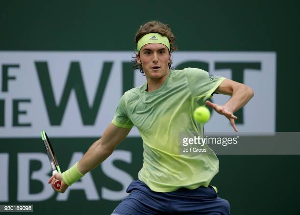Stefanos Tsitsipas of Greece returns a forehand to Dominic Thiem of Austria during the BNP Paribas Open on March 10 2018 at the Indian Wells Tennis...