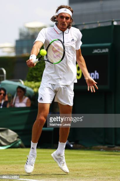 Stefanos Tsitsipas of Greece returns a shot against Jared Donaldson of the United States during their Men's Doubles first round match on day four of...