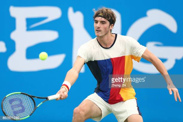 Stefanos Tsitsipas of Greece returns a shot during the match against Marcos Giron of the United States during Qualifying second round of 2017 ATP...