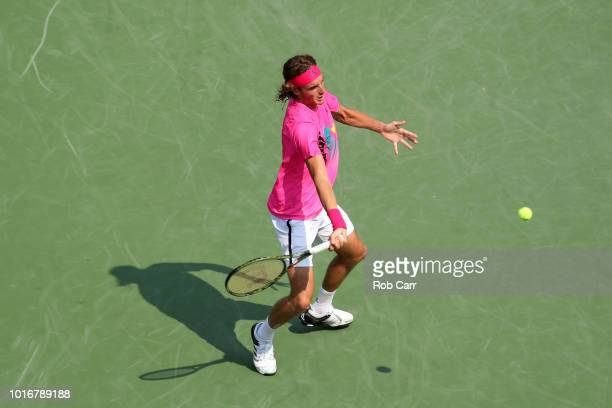 Stefanos Tsitsipas of Greece returns a shot to David Goffin of Belgium during Day 4 of the Western and Southern Open at the Lindner Family Tennis...