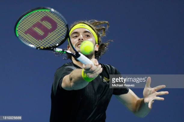 Stefanos Tsitsipas of Greece returns a shot to Lorenzo Sonego of Italy during the Miami Open at Hard Rock Stadium on March 30, 2021 in Miami Gardens,...