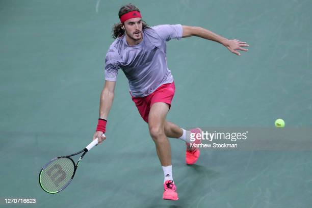 Stefanos Tsitsipas of Greece returns a volley during his Men's Singles third round match against Borna Coric of Croatia on Day Five of the 2020 US...