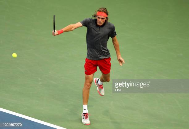 Stefanos Tsitsipas of Greece returns the ball during his men's singles first round match against Tommy Robredo of Spain on Day One of the 2018 US...