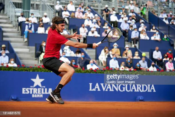 Stefanos Tsitsipas of Greece returns the ball during his Men's Singles final match against Rafael Nadal of Spain on day seven of the Barcelona Open...