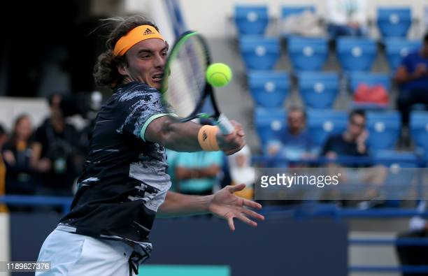 Stefanos Tsitsipas of Greece returns the ball to Andrey Rublev of Russia during their Mubadala World Tennis Championship match at Zayed Sports City...